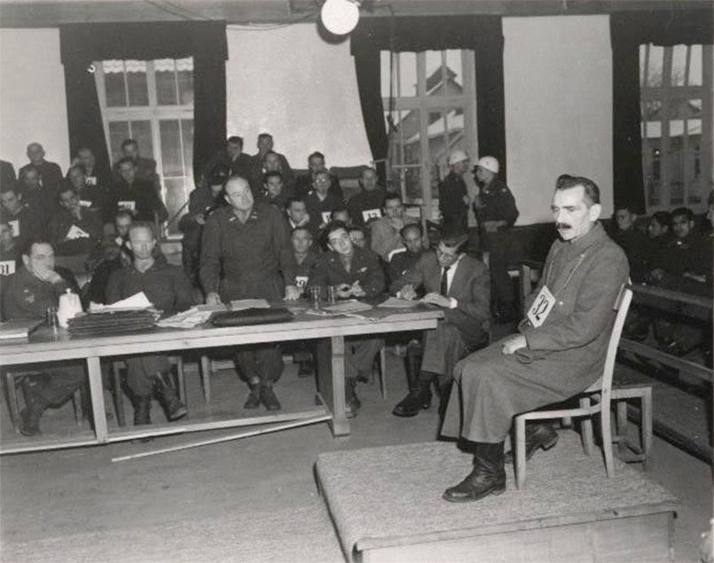 Defendant Wilhelm Witteler SS chief physician in Dachau concentration camp gives evidence at the US Dachau main concentration camp trial 1946 (source NARA).